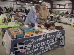 Carol Rothhaar of Bucyrus, left, and Linda Bauer, of Crestline, right, tend to their table Saturday during the Bucyrus Community Garage Sale. The event was held at the Bucyrus County Fairgrounds and was sponsored by the Bucyrus Kiwanis Club. Rothhaar and Bauer's table was support the Relay for Life American Cancer Society support group.