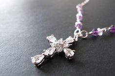 Cubic Zirconia cross with amethyst and rose quartz on both sides of ... Click to see how you can save $ on Cubic Zirconia Jewelry