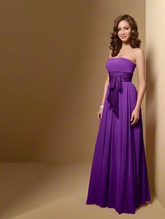 A Long Chiffon Bridesmaid Dress with an A-Line Silhouette, Floor Length Skirt, Contrasting Color Waistband, and Strapless Neckline