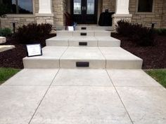 White stamped front entrance steps with lights Concrete Backyard, Concrete Driveways, Flagstone Patio, Cement Steps, Painted Brick Exteriors, Front Door Steps, White Concrete, Stamped Concrete, Patio Steps