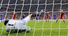 Crucial: Petr Cech saves from Arjen Roben in extra-time