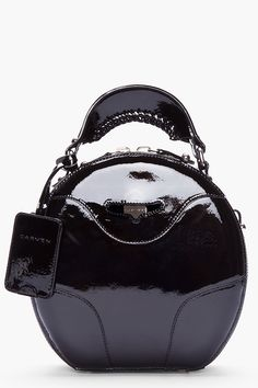 CARVEN black Patent leather Round Bag with silver tone hardware.