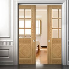 Double Pocket Kensington Oak Panel Door with Clear Bevelled Safety Glass, Prefinished. #internaldoors #pocketdoors #deantadoors