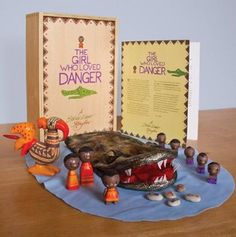 The Girl Who Loved Danger Storybox - Children will love using these hand painted pieces to re-enact the engaging story of a brave girl who confronts her fears. Based on an original African folk tale, the set also includes a hand puppet and story booklet.