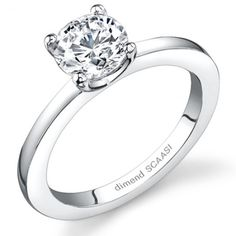 Modern solitaire engagement ring featuring clean flowing lines to create simple yet bold look.
