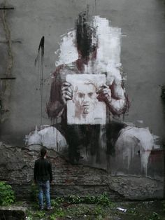 """""""Borondo born 1989 is a spanish street artist .  Graduated in art college IES Margarita Salas Madrid, he continues his fine arts studies in Madrid Complutense University. In 2012 he lands in Roma, Italy for an Erasmus cultural exchage program at Accademia di Belle Arti di Roma"""". More information about him at Gallery 999Contemporary."""