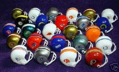 Mini NFL football helmets. Used to collect these out of the old quarter machines.