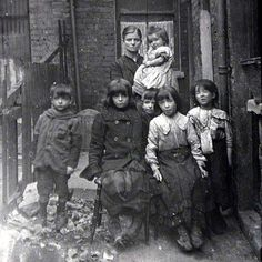 Family living in a slum in London. Date unknown.