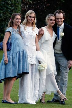 The model of the moment was maid of honor to her sister Poppy, when the socialite and model married James Cook in May.   - ELLE.com