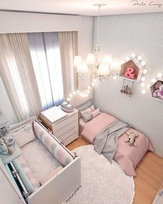 Very clean and simple but still very cute shared nursery children's room!