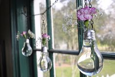 Set of 3 hanging Vases made from Recycled Light Bulbs.. $32.00, via Etsy.