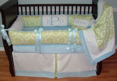 Addison Blue Damask Baby Bedding  This custom 3 pc baby crib bedding set includes, bumper pad, crib skirt, and blanket.  The green and white damask, white twill, blue grosgrain ribbon, and ultra soft blue and white minky combine softness and texture. The best for your little angel's nursery.