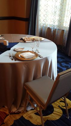 j js table setting at the marlowe silver tablecloth gold charger cream
