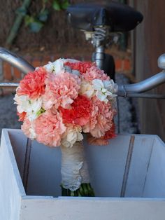 What a beautiful carnation bouquet!  This is a fantastic way to make inexpensive flowers look like a million bucks.