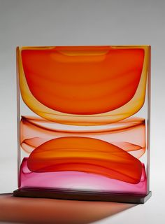 "Gorgeous pieces by Jamie Harris, a glass artist and designer living in New York City.   ""I approach my sculptural glass work more from a painterly perspective than as a traditional glassblower. My work is about loud splashes of color, about capturing the innate way glass transmits, reflects, and absorbs color. You can see the sensibility in a number of approaches, from the strictness of my blown work to the organic looseness of my cast wall panels. Yet all of my work shares a similar lov..."