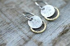 Small solar eclipse earrings handmade with sterling silver and brass. Silver moon embellished with texture from a hammer, brass accented with lines to represent the rays of the sun. Simple solar eclipse jewelry to hallmark this momentous occasion. 2017 solar eclipse. ~All jewelry is