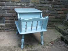 This mid century end table is so pretty! It is chalk painted in Annie Sloan Duck Egg Blue with French Linen (light gray) spindles. It has