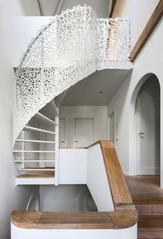 Maxwan Architects, Rotterdam, renovation of 1938 seaside villa, adding new to old both in exterior & interior architecture. Custom spiral staircase with laser cut pattern blends from closed to open