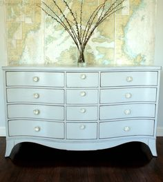 gray and glass knob bureau