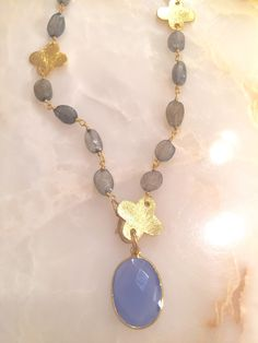 A personal favorite from my Etsy shop https://www.etsy.com/listing/239908758/blue-chalcedony-pendant-and-24k-gold