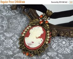New to fripparie on Etsy: 50% Off Victorian Cameo Choker Necklace Jewelry - Bronze Tone Red and Ivory Black Velvet Ribbon Made with Swarovski Elements Rhinestones (24.50 USD)