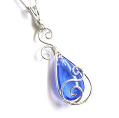 Graceful and elegant pendant necklace is handcrafted with a beautiful royal blue glass briolette and sterling silver-filled* wire. Pendant comes with an Italian-made, silver filled curb chain with a 925 sterling spring clasp in your choice of length. Simply select your desired length