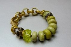 Natural Yellow Turquoise Gemstone Bracelet with Citrine, Lampwork Bead, and Antique Gold. $73.00, via Etsy.