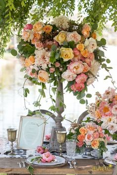 Photographer: She Wanders Photography; Breathtaking colorful flower wedding reception centerpiece with different flower types;