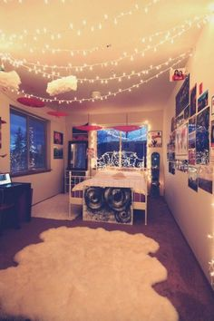 I like the way the lights are strung: just from the corners and allowed to drape a bit. The room is intriguing, but I wouldn't want windows like that in my bedroom.
