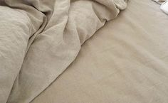 A Smooth natural sheet on the right perfectly matches the color of the Orkney natural duvet cover.