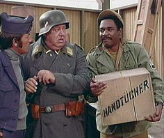 Kinch is holding explosives - he's telling Schultz it's a case of wine to go on the truck