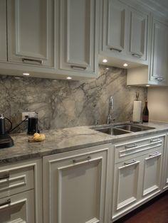 quartz countertops | Quartz countertop in white fantasy Like the countertops, not the backsplash.