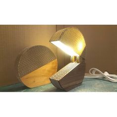 Switcha Lamp - Table lamp made of cardboard, with a wooden base. The lamp has no switch: it is turned on and off by lifting and lowering the lampshade. In the inside there is one 7W 220 Volt led light bulb.