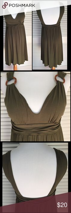 VS Olive Green Bra Top Dress Perfect for your Beach Vacation! V-Neck, square back. Decorative rings appear to be Resin but there is no info on the tag description. Works great as a Swimsuit Cover as well.  Body 94% Modal 6% Spandex. Bra 95% Supma Cotton 5% Spandex. Great used condition. So fun to wear! This dress has light pilling and priced to reflect condition. It would not stop me from wearing it! Victoria's Secret Dresses