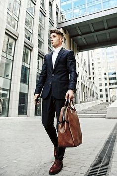 Shop this look for $367:  http://lookastic.com/men/looks/blazer-and-dress-shirt-and-tote-bag-and-dress-pants-and-oxford-shoes/2633  — Black Blazer  — White Dress Shirt  — Brown Leather Tote  — Black Dress Pants  — Brown Leather Oxford Shoes