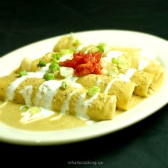 Pork enchiladas with creamy poblano sauce--I'd use a veggie filling but want this for the sauce