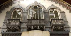 Elegant cast iron windows and decorative balconies at Paddington Station