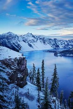 Oregon:  A sweeping view of snow-covered mountains from Crater Lake National Park.