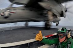 """Thumbs up"" takes on a whole new meaning when you're in charge of launching #USNavy's E-2C Hawkeye."