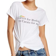 Wildfox's '24 Carats short sleeve tee' Wildfox's '24 Carat short sleeve Tee' is a casual humble tee that delivers a more subtle message of a luxury tee! Frontal graphics, wide crew neck...relaxed fit is your perfect spring to summer attire! Cute cute! Wildfox Tops Tees - Short Sleeve