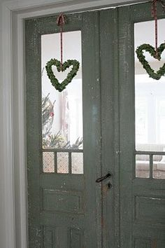 Love the idea of hanging small wreaths in windows Christmas Door, All Things Christmas, White Christmas, Christmas Time, Xmas, Simple Christmas, Shutter Doors, Old Doors, Christmas Inspiration