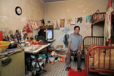 German photographer Michael Wolf takes 100 pictures of 100 Hong Kong homes which measure square feet. Tiny Living, Small Space Living, Living Spaces, Living Room, Kowloon Hong Kong, Kowloon Walled City, Michael Wolf, Wolf Photography, Tiny Spaces