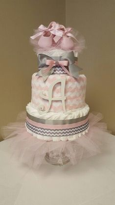 """Tiny Dancer"" Pink and gray baby girl diaper cake with ballerina slippers. Pink Diaper Cakes, Diy Diaper Cake, Nappy Cake, Princess Diaper Cakes, Regalo Baby Shower, Baby Shower Diapers, Baby Shower Parties, Baby Shower Gifts, Baby Slippers"