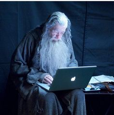 Gandalf checks his emails (behind the scenes on the set of The Hobbit). // haha! D'awww.