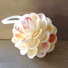 """Seashells handmade into this gorgeous shell flower ball. All Natural white shells. A Beautiful Ornament to treasure. Small Size -between 1-2"""" inches Large 3"""""""