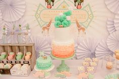 Holy Goodness! I am enthralled with all the details created for this little girl's circus birthday party... I particularly love the gold animals, ruffled ombre cakes, and pompom cake topper.
