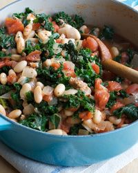Kale and White-Bean Stew. Combining Two Portuguese favorites—kale-and-sausage soup and a bean, sausage, and tomato stew—I'll adapt this to be vegetarian for me.makes a simple, sensational one-pot meal. Kale Recipes, Soup Recipes, Vegetarian Recipes, Dinner Recipes, Cooking Recipes, Healthy Recipes, Cooking Bacon, Snack Recipes, Giada De Laurentiis