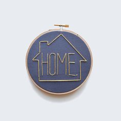 HOME. Perfect for your minimalist decor!  This lovely item was hand stitched using yellow silk thread to create a minimalist pattern. It is