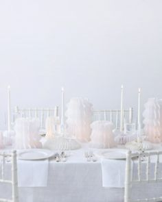 Paper Lantern Centerpieces, so dreamy.. Use crystal and glass everything. Then use the paper lanterns with tall glass cylinders that are safe for flames... All white, so elegant.  Sunshine:-)