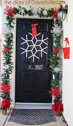 popsicle stick door ornament.  Looks easy and we neeeed some holiday spirit on the exterior.  We're bringing down the neighborhood. ha.